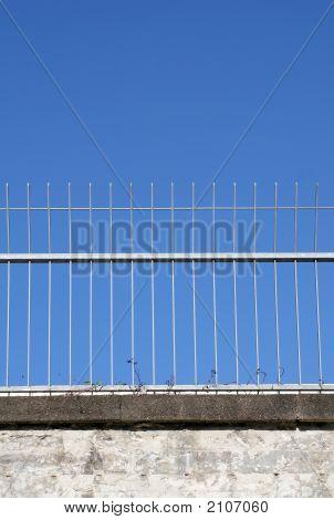Fence Against Blue Sky