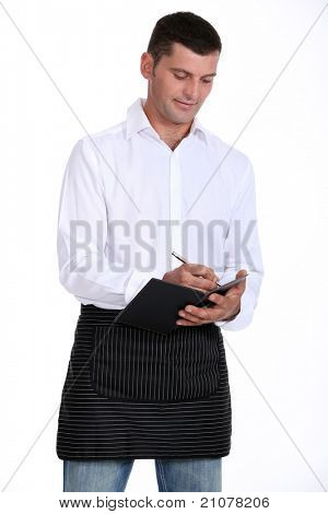 Male waiter taking order