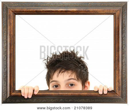 Child Peeking Out Of Ornate Wooden Frame
