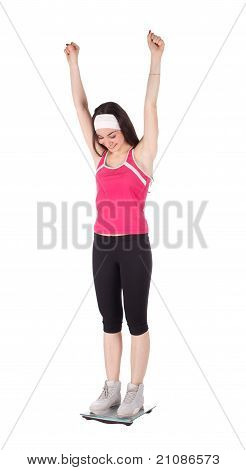 Very Happy Woman On A Scale For Weight Loss Concept