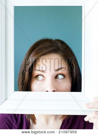 Silly Woman Peeking Out From A Vintage Picture Frame
