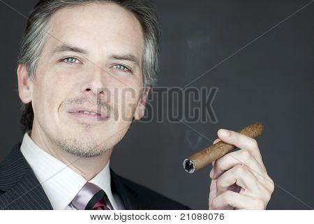 Confident Businessman Holds Cigar