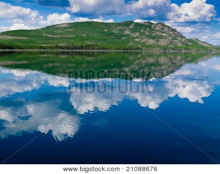 Yukon wilderness reflected on calm lake