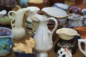 pic of bric-a-brac  - Collection of old jugs and ornaments on a market stall - JPG