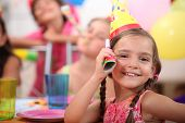 image of birthday party  - Young girl at a child - JPG