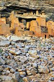 picture of dogon  - Vertical image of ancient Dogon and Tellem houses at the base of the Bandiagara escarpment in Mali - JPG
