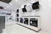 Gas stoves and electric ovens, cooker hoods other appliance or equipment in the retail store showroo poster