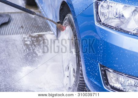 poster of Manual Car Wash With Pressurized Water In Car Wash Outside.cleaning Car Using High Pressure Water.