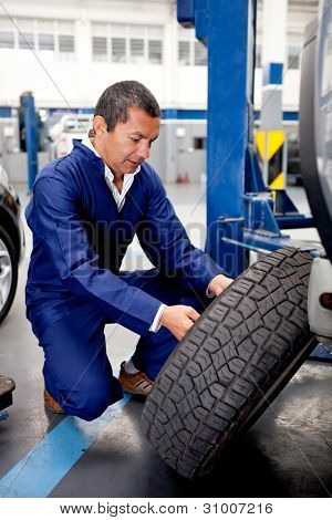 Mechanic fixing car wheel after a puncture