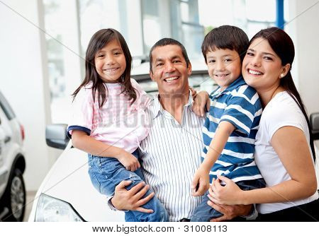 Happy family buying a new car at the dealer