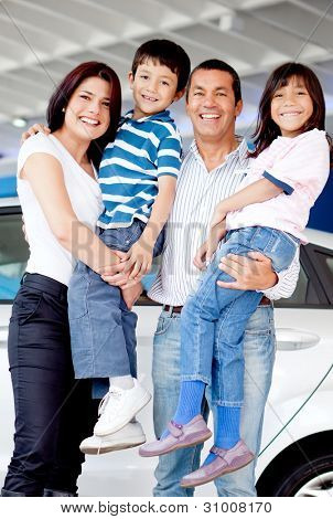 Happy family at the dealer buying a new car
