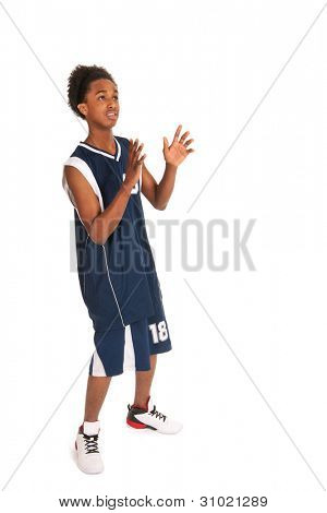 Black basketball player standing in the studio