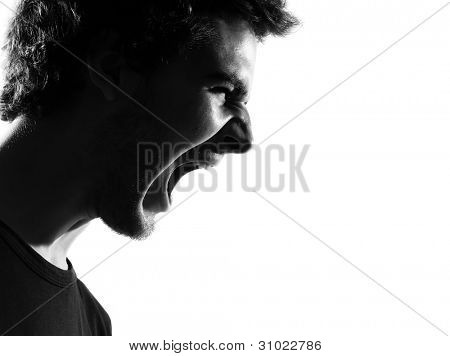 young man screaming angry portrait silhouette in studio isolated on white background