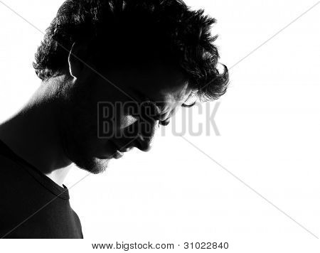 young man sad silhouette in studio isolated on white background