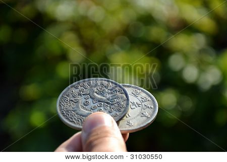 Big silver coins with dragon