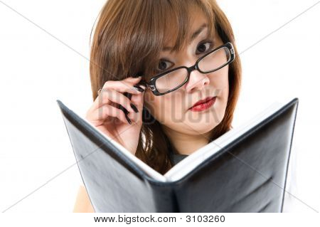 The Young Japanese Business Woman Looking At Note