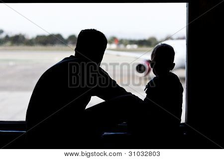Father And Son At The Airport