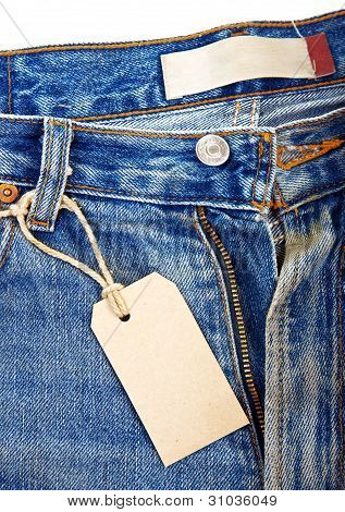 unbuttoned blue jeans with paper label