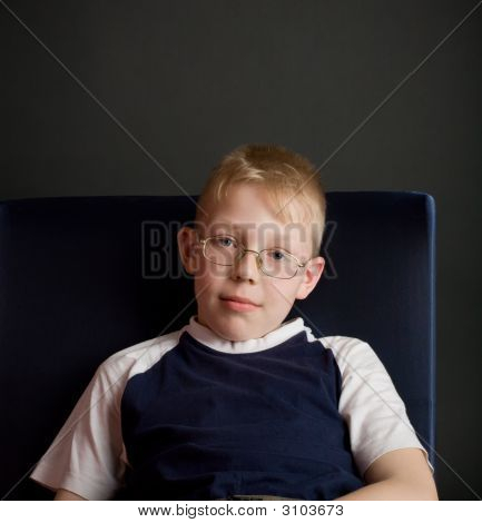Confident Boy Sit On Chair