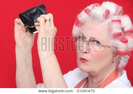 grandma with hair curlers and empty purse