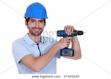 Unshaven worker with power drill