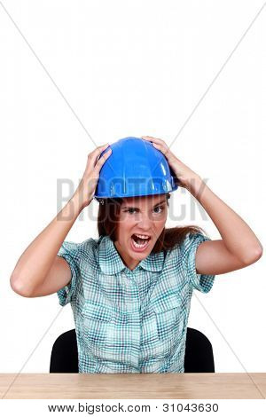 A scowling female construction worker.