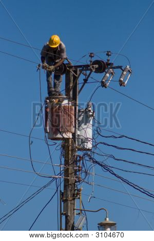 Electrician Repairs A Wire Of The Power Line