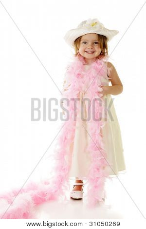 A beautiful preschooler all dressed up in white with a feathery pink boa draped around her shoulders.  On a white background.