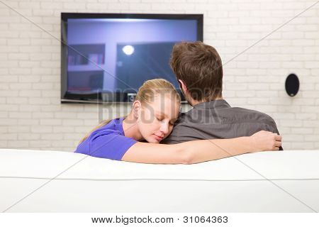 Man Watching Tv Woman Embraces Him