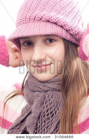 Beautiful teenage girl wearing fashionable cap, sweater and scarf