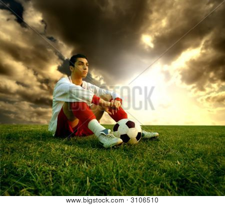 a young soccer player and a sunset