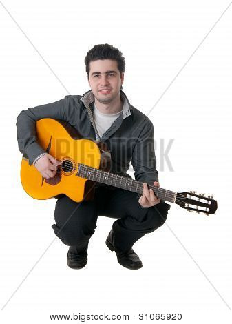 The Musician Plays An Acoustic Guitar