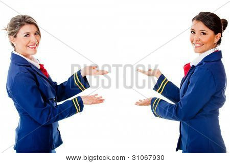 Welcoming air hostesses - isolated over a white background