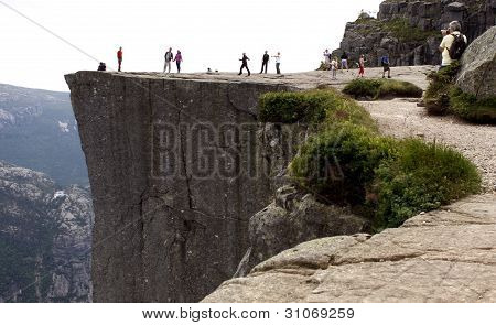PULPIT ROCK, NORWAY - CIRCA JULY 2010. Visitors stand on the Pulpit Rock. Editorial use!