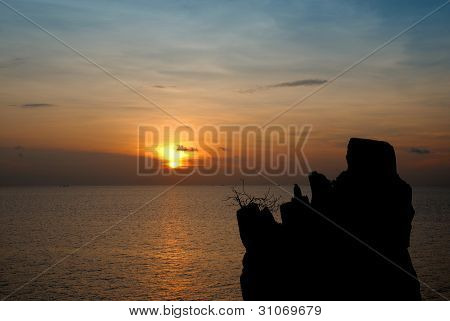 A Lone Rock In The Sea Sunset