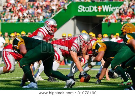 VIENNA, AUSTRIA - JULY 15: Teams Austria and Australia at the line of scrimmage at the Football World Championship on July 15, 2011 in Vienna, Austria.