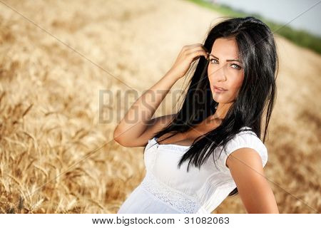 Portrait of one beautiful young woman posing outdoor