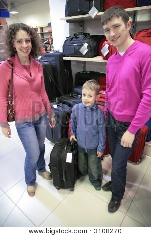 Family Buys Suitcase In Shop