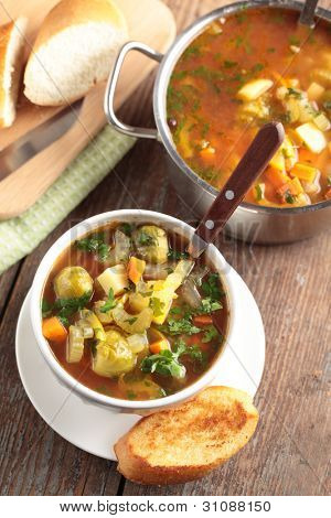 Minestrone on a rustic table. Top view