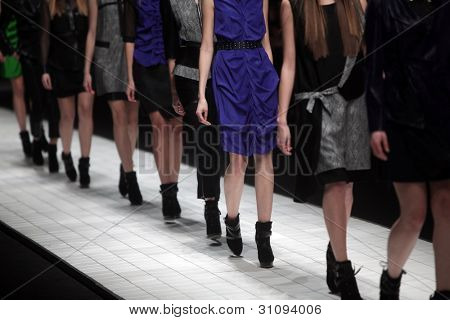 "ZAGREB, CROATIA - MARCH 16: Fashion model wears clothes made by Ana Maria Ricov on ""Dove FASHION.HR"" show on March 16, 2012 in Zagreb, Croatia."