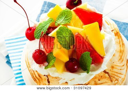 Pavlova With Fresh Fruit (mango, Pineapple, Watermelon, Cherry) Ready  To Serve, On White Background