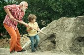 Little Son Helping His Father With Building Work. Childhood Concept. Future Worker Son With Father.  poster