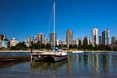 Cruising Catamaran Moored At False Creek Wharf In Downtown Of Vancouver City, The Beach And Resident poster