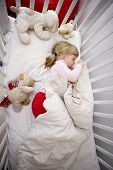 stock photo of goodnight  - Baby Girl in her bed at home - JPG
