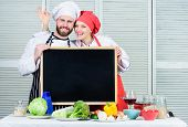 A Lot Of Fun Cooking Class. Master Cook And Prep Cook Gesturing Ok Sign At Board. Couple Of Man And  poster