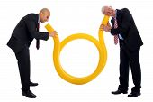 picture of brig  - Business Communication with a yellow tube and two men - JPG