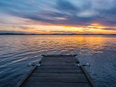 Calm, Serenity, Meditation Concept. Sunset On The Lake, Wooden Bridge In The Foreground, Quiet Water poster