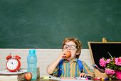 Funny Little Boy In Glasses Sits At Desk In Classroom. Kid In Classroom Have School Lunch. Schoolboy poster