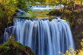The small Croatian town. Numerous picturesque waterfalls of the Sluncica River flowing through the c poster