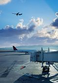 Transportation image of commercial passenger airplane and departure gate at airport over sky with fl poster